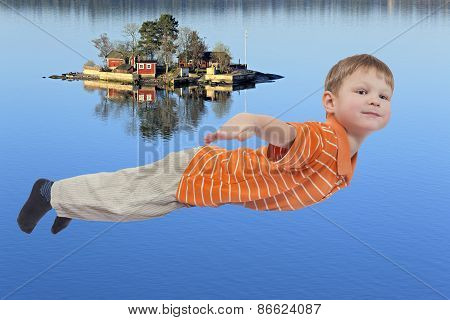 Young boy flying  and sea island in background