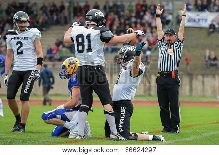 GRAZ, AUSTRIA - APRIL 04, 2014: WR Jan Dundacek (#11 Panthers) celebrates a touchdown in an AFL football game.