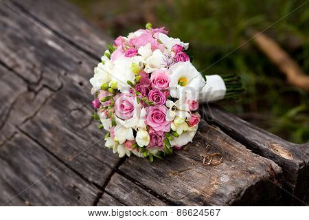 Pink And White Wedding Bouquet On Wood