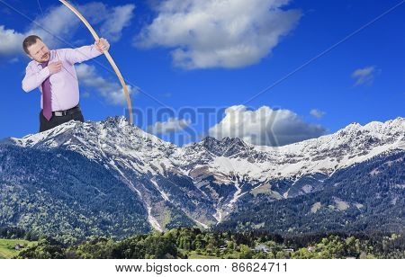 Businessman practicing archery and mountain valley in foreground