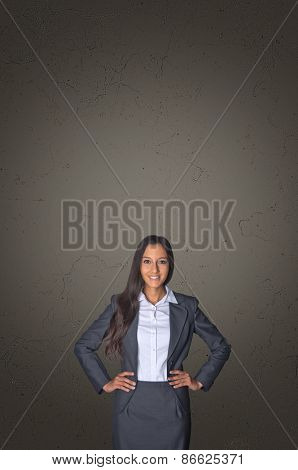Confident Young Businesswoman on Abstract Gray Gradient Background with Copy Space.