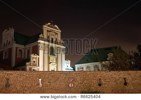 Baroque church by medieval wall