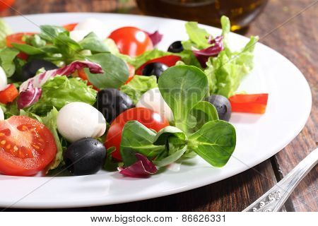 Salad With A Mozzarella, Tomatoes, Olives, Salad