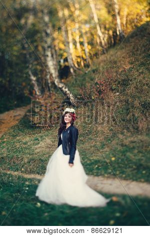 Bride in corolla in a forest