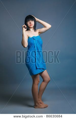 European-looking girl of about twenty brunette shook in blue tow