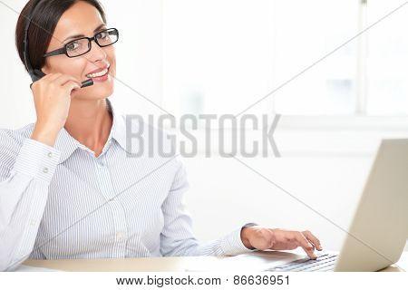Charming Callcenter Employee Working On Desk