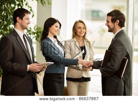 Group of business people congratulating their handshaking