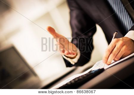 successful businessman giving a hand