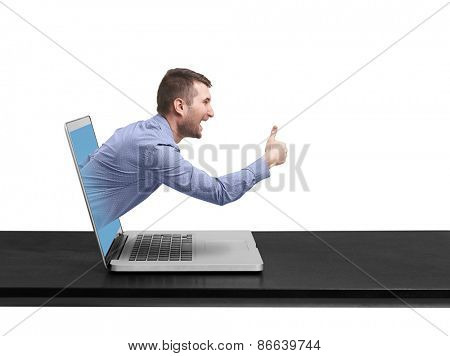 excited man got out of the laptop and showing thumbs up against white background