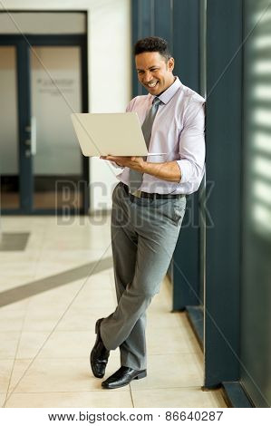 modern business man using laptop computer in office