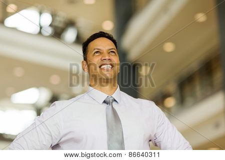 handsome mid age business executive looking up