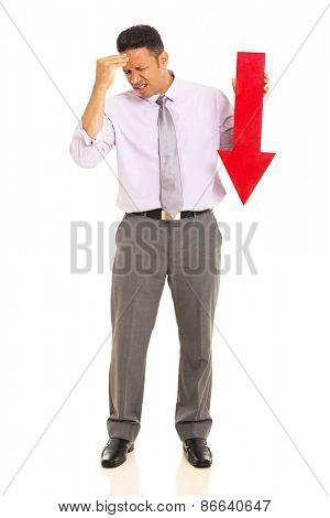 stressed mature businessman holding arrow pointing down on white background
