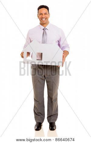 handsome mid age businessman holding white paper house