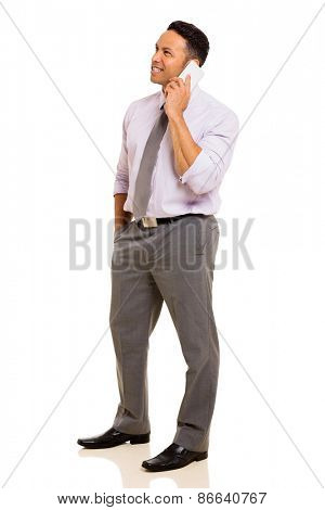 side view of mid age businessman talking on mobile phone