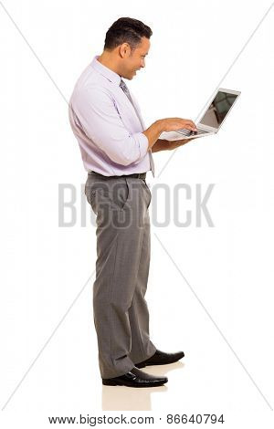 professional mature businessman using laptop on white background