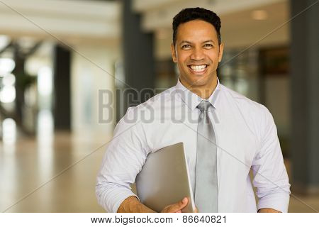 modern middle aged businessman with laptop computer in office