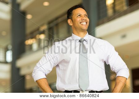 joyful middle aged business man daydreaming