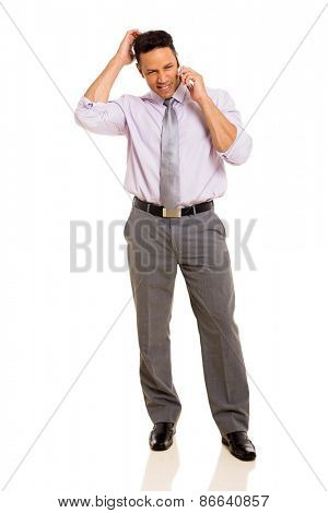 good looking businessman talking on mobile phone isolated on white