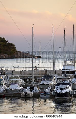 Marina Pier With Yachts At Sunset In Croatia