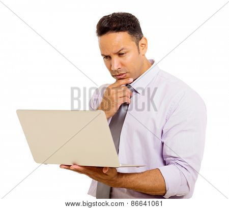 handsome mid age businessman reading email on his laptop