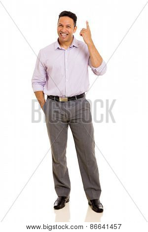 handsome businessman pointing up on white background