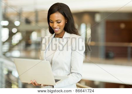 successful black businesswoman working on laptop in office
