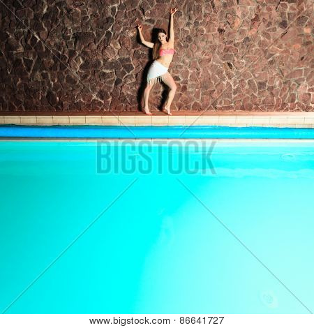 Attractive Standing Woman On Pool Edge.