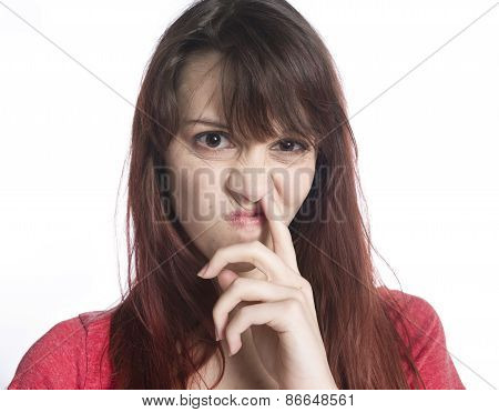 Close up Young Woman Picking her Nose