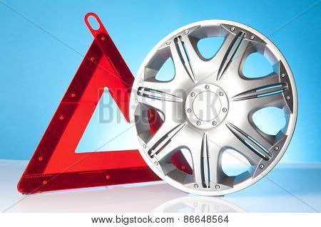 Alloy wheel with warning triangle