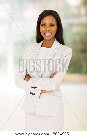 portrait of afro american businesswoman with arms crossed in office