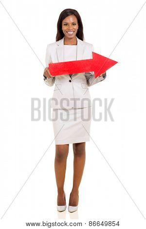 afro american businesswoman holding red arrow isolated on white