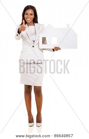 pretty afro american woman holding paper house and giving thumb up