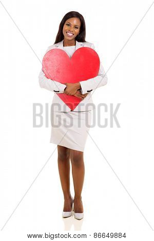 beautiful african american woman hugging red heart shape
