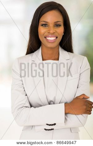 attractive young african woman indoors