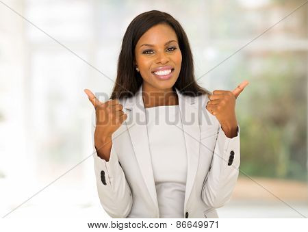 cheerful african american businesswoman giving thumbs up