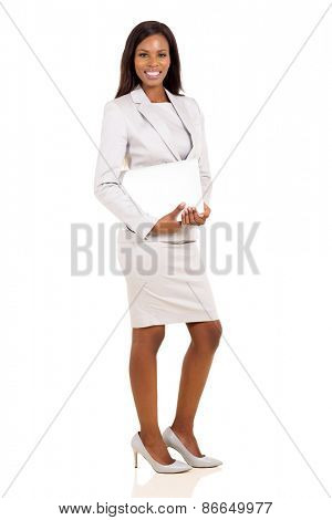 successful young african businesswoman holding laptop on white background