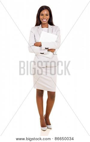attractive young businesswoman holding laptop on white background