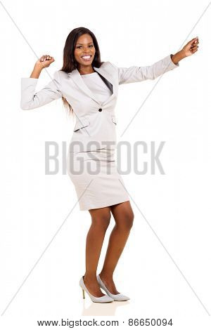 cheerful young african american businesswoman dancing isolated on white background