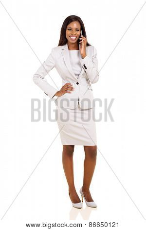 pretty african american businesswoman talking on mobile phone isolated on white