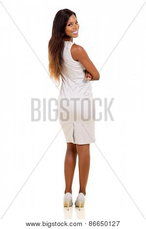 beautiful african american businesswoman looking back isolated on white