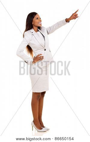 attractive african woman pointing at empty copy space