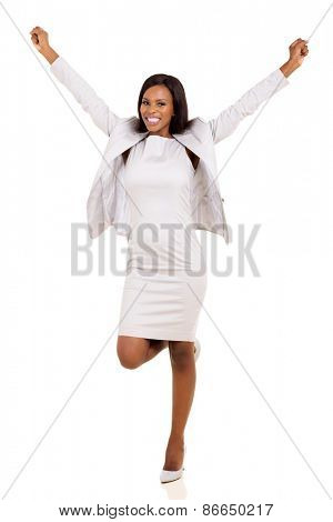 joyful young african american businesswoman arms up isolated on white