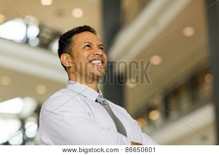 happy middle aged business man in modern office