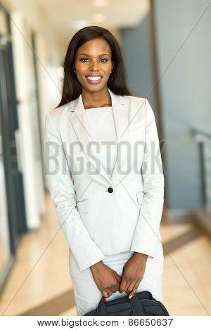 attractive african businesswoman holding briefcase