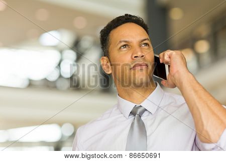 good looking mid age man talking on cell phone