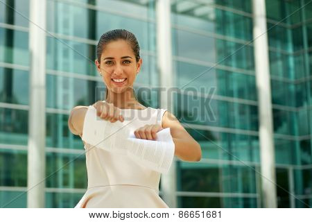 Young Business Woman Tears Pages Of Contract Smiling