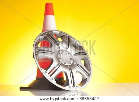 Alloy wheel with road emergency items