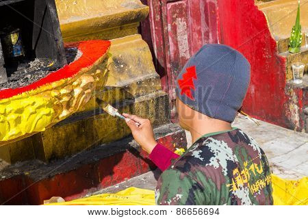 The Worker Is Painting Gold Color On Joss Stick Pot