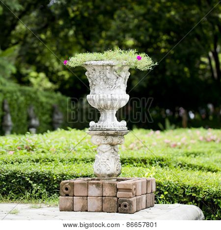 Stone Planter With Flowers In Park