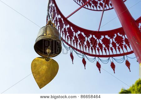 Bell Hanging From Traditional Metal Umbrella